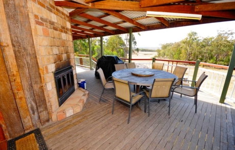 Outside fireplace and large deck